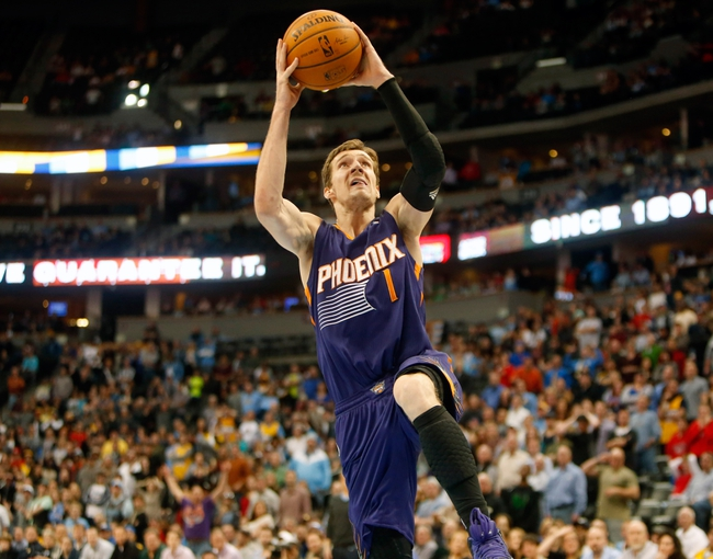 Feb 18, 2014; Denver, CO, USA; Phoenix Suns guard Goran Dragic (1) shoots the ball during the overtime period against the Denver Nuggets at Pepsi Center.  The Suns won 112-107 in overtime.  Mandatory Credit: Chris Humphreys-USA TODAY Sports