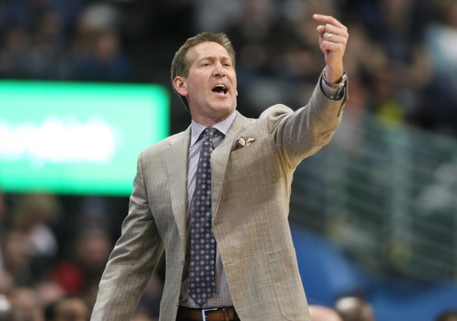 Feb 18, 2014; Denver, CO, USA; Phoenix Suns head coach Jeff Hornaceck signals to his team during the second half against the Denver Nuggets at Pepsi Center.  The Suns won 112-107 in overtime.  Mandatory Credit: Chris Humphreys-USA TODAY Sports
