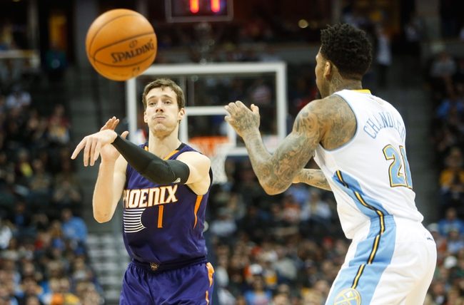 Feb 18, 2014; Denver, CO, USA; Phoenix Suns guard Goran Dragic (1) passes the ball during the second half against the Denver Nuggets at Pepsi Center. The Suns won 112-107 in overtime.  Mandatory Credit: Chris Humphreys-USA TODAY Sports