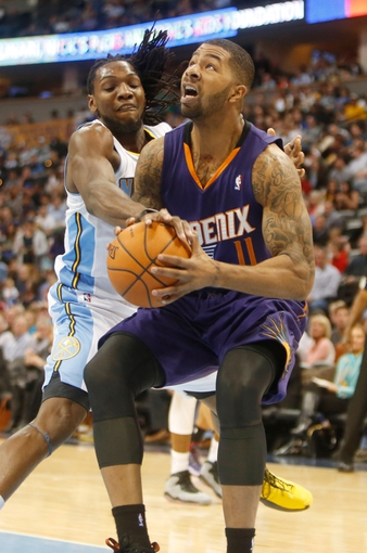 Feb 18, 2014; Denver, CO, USA; Phoenix Suns forward Markieff Morris (11) is fouled by Denver Nuggets forward Kenneth Faried (35) during the second half at Pepsi Center.  The Suns won 112-107 in overtime.  Mandatory Credit: Chris Humphreys-USA TODAY Sports