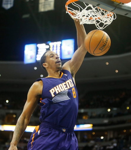 Feb 18, 2014; Denver, CO, USA; Phoenix Suns forward Channing Frye (8) dunks the ball during the first half against the Denver Nuggets at Pepsi Center. The Suns won 112-107 in overtime.  Mandatory Credit: Chris Humphreys-USA TODAY Sports