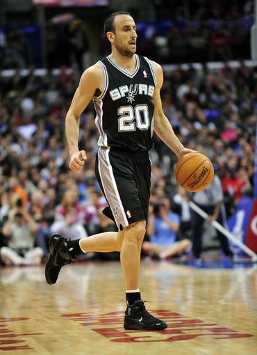 February 18, 2014; Los Angeles, CA, USA; San Antonio Spurs shooting guard Manu Ginobili (20) moves the ball up court against the Los Angeles Clippers during the second half at Staples Center. Mandatory Credit: Gary A. Vasquez-USA TODAY Sports