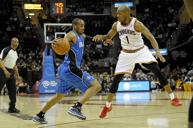 Feb 19, 2014; Cleveland, OH, USA; Orlando Magic shooting guard Arron Afflalo (4) dribbles against Cleveland Cavaliers point guard Jarrett Jack (1) in the first quarter at Quicken Loans Arena. Mandatory Credit: David Richard-USA TODAY Sports