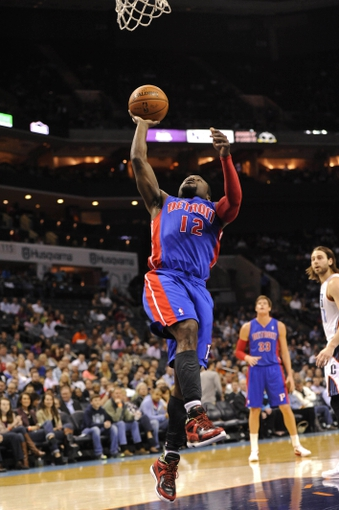 Feb 19, 2014; Charlotte, NC, USA; Detroit Pistons guard Will Bynum (12) drives to the basket and scores during the first half of the game against the Charlotte Bobcats at Time Warner Cable Arena. Mandatory Credit: Sam Sharpe-USA TODAY Sports