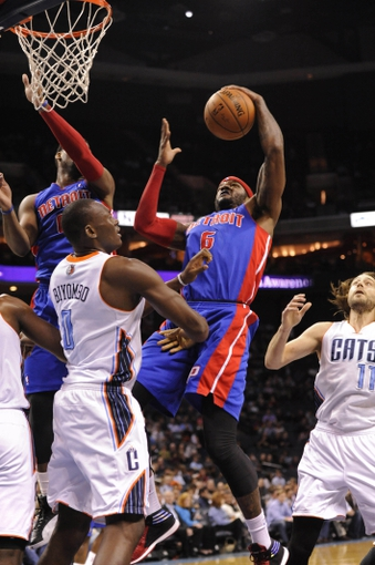 Feb 19, 2014; Charlotte, NC, USA; Detroit Pistons forward Josh Smith (6) drives to the basket and runs into Charlotte Bobcats forward center Bismack Biyombo (0) during the first half of the game at Time Warner Cable Arena. Mandatory Credit: Sam Sharpe-USA TODAY Sports
