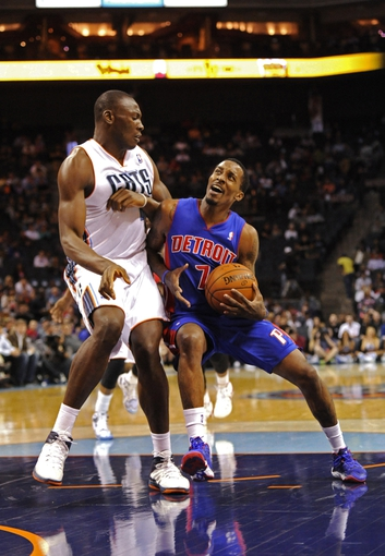 Feb 19, 2014; Charlotte, NC, USA; Detroit Pistons guard Brandon Jennings (7) drives to the basket while defended by Charlotte Bobcats forward center Bismack Biyombo (0) during the first half of the game at Time Warner Cable Arena. Mandatory Credit: Sam Sharpe-USA TODAY Sports