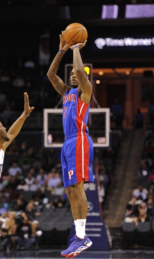Feb 19, 2014; Charlotte, NC, USA; Detroit Pistons guard Brandon Jennings (7) shoots during the first half of the game against the Charlotte Bobcats at Time Warner Cable Arena. Mandatory Credit: Sam Sharpe-USA TODAY Sports