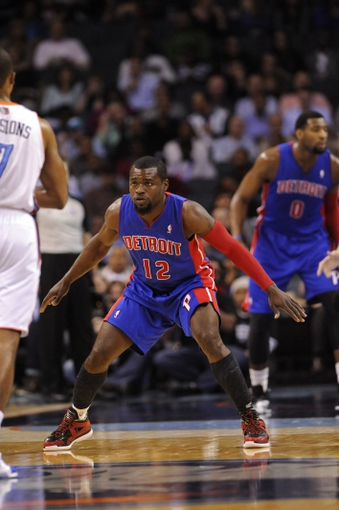 Feb 19, 2014; Charlotte, NC, USA; Detroit Pistons guard Will Bynum (12) defends against Charlotte Bobcats guard Ramon Sessions (7) during the first half of the game against the Charlotte Bobcats at Time Warner Cable Arena. Mandatory Credit: Sam Sharpe-USA TODAY Sports