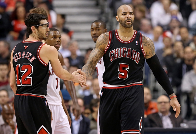 Feb 19, 2014; Toronto, Ontario, CAN; Chicago Bulls forward Carlos Boozer (5) celebrates with guard Kirk Hinrich (12) after scoring a basket against the Toronto Raptors at Air Canada Centre. The Bulls beat the Raptors 94-92. Mandatory Credit: Tom Szczerbowski-USA TODAY Sports