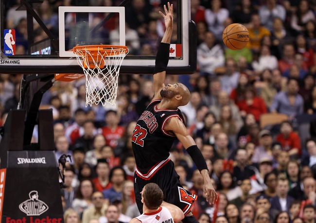 Feb 19, 2014; Toronto, Ontario, CAN; Chicago Bulls forward Taj Gibson (22) misses an attempted alley-oop against the Toronto Raptors at Air Canada Centre. The Bulls beat the Raptors 94-92. Mandatory Credit: Tom Szczerbowski-USA TODAY Sports