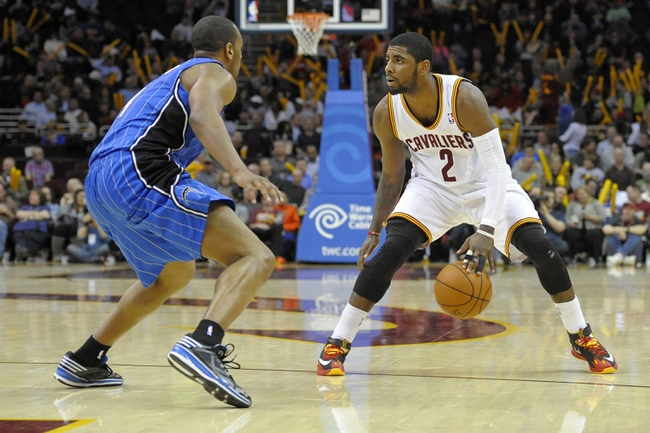 Feb 19, 2014; Cleveland, OH, USA; Cleveland Cavaliers point guard Kyrie Irving (2) dribbles against Orlando Magic shooting guard Arron Afflalo (4) in the third quarter at Quicken Loans Arena. Mandatory Credit: David Richard-USA TODAY Sports