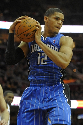 Feb 19, 2014; Cleveland, OH, USA; Orlando Magic small forward Tobias Harris (12) grabs a rebound in the fourth quarter against the Cleveland Cavaliers at Quicken Loans Arena. Mandatory Credit: David Richard-USA TODAY Sports