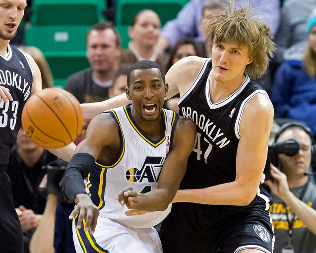 Feb 19, 2014; Salt Lake City, UT, USA; Utah Jazz small forward Jeremy Evans (40) gets a pass away while defended by Brooklyn Nets small forward Andrei Kirilenko (47) during the first half at EnergySolutions Arena. Mandatory Credit: Russ Isabella-USA TODAY Sports