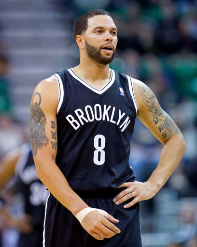 Feb 19, 2014; Salt Lake City, UT, USA; Brooklyn Nets point guard Deron Williams (8) reacts during the first half against the Utah Jazz at EnergySolutions Arena. Mandatory Credit: Russ Isabella-USA TODAY Sports