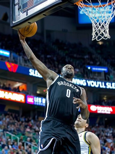Feb 19, 2014; Salt Lake City, UT, USA; Brooklyn Nets center Andray Blatche (0) dunks during the first half against the Utah Jazz at EnergySolutions Arena. Mandatory Credit: Russ Isabella-USA TODAY Sports