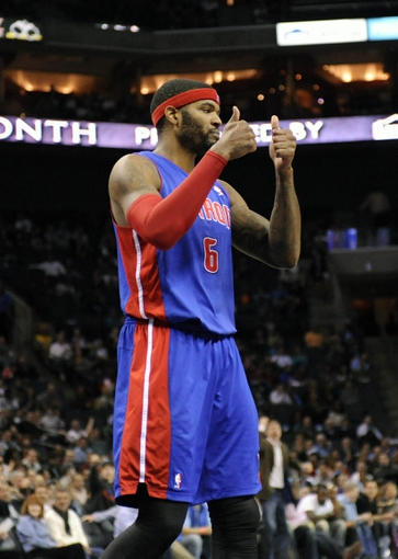 Feb 19, 2014; Charlotte, NC, USA; Detroit Pistons forward Josh Smith (6) gives his approval to a foul call during the second half of the game against the Charlotte Bobcats at Time Warner Cable Arena. Bobcats win 116-98. Mandatory Credit: Sam Sharpe-USA TODAY Sports
