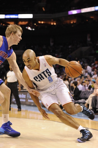 Feb 19, 2014; Charlotte, NC, USA; Charlotte Bobcats guard Gerald Henderson (9) drives past Detroit Pistons forward Kyle Singler (25) during the second half of the game at Time Warner Cable Arena. Bobcats win 116-98. Mandatory Credit: Sam Sharpe-USA TODAY Sports