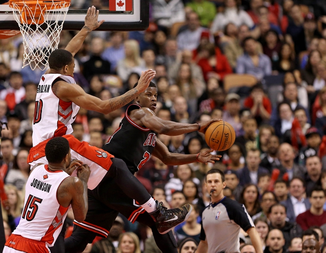 Feb 19, 2014; Toronto, Ontario, CAN; Chicago Bulls forward Jimmy Butler (21) passes the ball against the Toronto Raptors at Air Canada Centre. The Bulls beat the Raptors 94-92. Mandatory Credit: Tom Szczerbowski-USA TODAY Sports