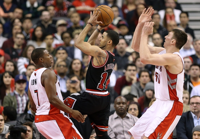 Feb 19, 2014; Toronto, Ontario, CAN; Chicago Bulls guard D.J. Augustin (14) goes to the basket against the Toronto Raptors at Air Canada Centre. The Bulls beat the Raptors 94-92. Mandatory Credit: Tom Szczerbowski-USA TODAY Sports