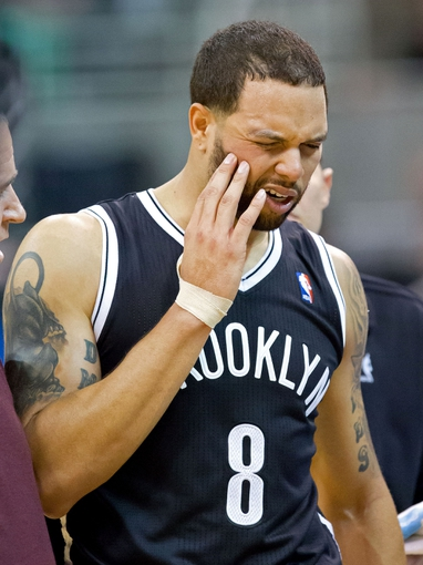 Feb 19, 2014; Salt Lake City, UT, USA; Brooklyn Nets point guard Deron Williams (8) walks off the court after being injured during the second half against the Utah Jazz at EnergySolutions Arena. The Nets won 105-99. Mandatory Credit: Russ Isabella-USA TODAY Sports