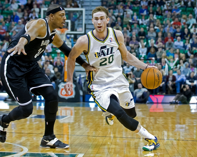 Feb 19, 2014; Salt Lake City, UT, USA; Utah Jazz shooting guard Gordon Hayward (20) dribbles the ball around Brooklyn Nets small forward Paul Pierce (34) during the second half at EnergySolutions Arena. The Nets won 105-99. Mandatory Credit: Russ Isabella-USA TODAY Sports