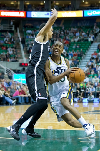 Feb 19, 2014; Salt Lake City, UT, USA; Utah Jazz point guard Alec Burks (10) drives to the basket against Brooklyn Nets point guard Shaun Livingston (14) during the second half at EnergySolutions Arena. The Nets won 105-99. Mandatory Credit: Russ Isabella-USA TODAY Sports