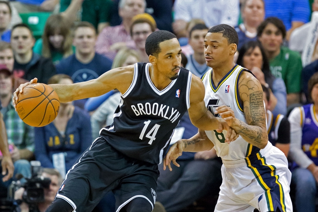 Feb 19, 2014; Salt Lake City, UT, USA; Utah Jazz point guard Diante Garrett (8) defends against Brooklyn Nets point guard Shaun Livingston (14) during the second half at EnergySolutions Arena. The Nets won 105-99. Mandatory Credit: Russ Isabella-USA TODAY Sports