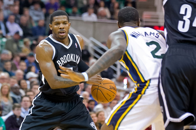 Feb 19, 2014; Salt Lake City, UT, USA; Utah Jazz power forward Marvin Williams (2) defends against Brooklyn Nets shooting guard Joe Johnson (7) during the first half at EnergySolutions Arena. The Nets won 105-99. Mandatory Credit: Russ Isabella-USA TODAY Sports