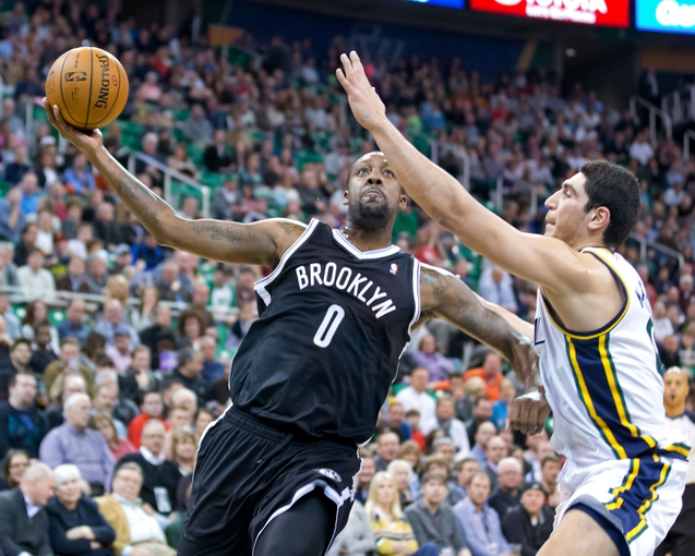 Feb 19, 2014; Salt Lake City, UT, USA; Brooklyn Nets center Andray Blatche (0) drives to the basket against Utah Jazz center Enes Kanter (0) during the first half at EnergySolutions Arena. The Nets won 105-99. Mandatory Credit: Russ Isabella-USA TODAY Sports