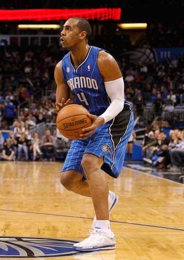 Jan 31, 2014; Orlando, FL, USA; Orlando Magic shooting guard Arron Afflalo (4) shoots against the Milwaukee Bucks during the second half at Amway Center. Orlando Magic defeated the Milwaukee Bucks 113-102.  Mandatory Credit: Kim Klement-USA TODAY Sports