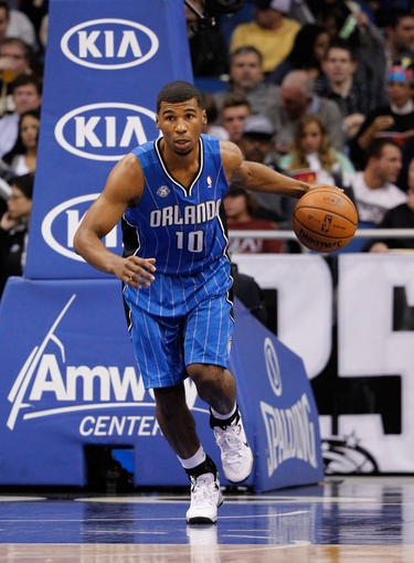 Jan 31, 2014; Orlando, FL, USA; Orlando Magic point guard Ronnie Price (10) dribbles the ball against the Orlando Magic  during the second half at Amway Center. Orlando Magic defeated the Milwaukee Bucks 113-102.  Mandatory Credit: Kim Klement-USA TODAY Sports