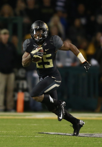 Nov 7, 2013; Waco, TX, USA; Baylor running back Lache Seastrunk (25) in game action against the Oklahoma Sooners  at Floyd Casey Stadium. Mandatory Credit: Tim Heitman-USA TODAY Sports