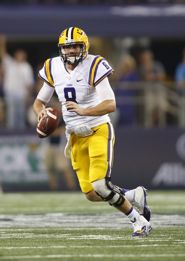 Aug 31, 2013; Arlington, TX, USA; LSU Tigers quarterback Zach Mettenberger (8) scrambles during the game against the TCU Horned Frogs at Cowboys Stadium. LSU Tigers beat TCU Horned Frogs 37-27. Mandatory Credit: Tim Heitman-USA TODAY Sports