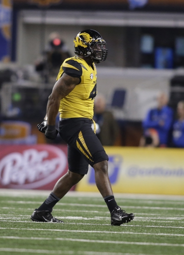 Jan 3, 2014; Arlington, TX, USA; Missouri Tigers defensive end Kony Ealy (47) in game action against the Oklahoma State Cowboys  at the 2014 Cotton Bowl at AT&T Stadium. Mandatory Credit: Tim Heitman-USA TODAY Sports