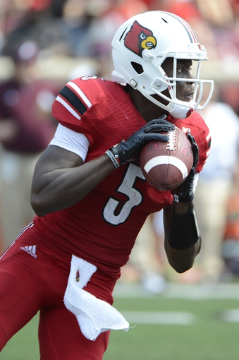 Sep 7, 2013; Louisville, KY, USA; Louisville Cardinals quarterback Teddy Bridgewater (5) looks to pass during the second half against the Eastern Kentucky Colonels at Papa John's Cardinal Stadium. Louisville defeated Eastern Kentucky 44-7.  Mandatory Credit: Jamie Rhodes-USA TODAY Sports
