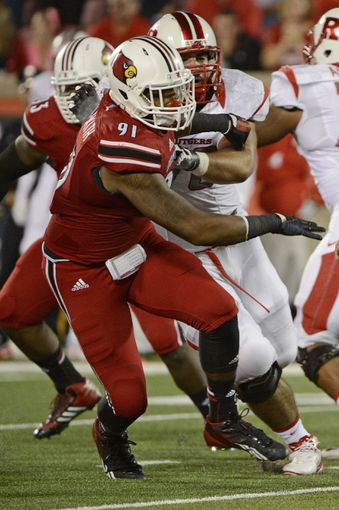 Oct 10, 2013; Louisville, KY, USA; Louisville Cardinals defensive end Marcus Smith (91) rushes past the Rutgers Scarlet Knights offensives line during the first quarter at Papa John's Cardinal Stadium. Mandatory Credit: Jamie Rhodes-USA TODAY Sports