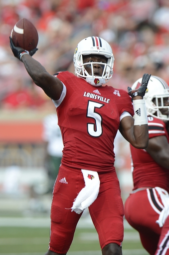 Sep 1, 2013; Louisville, KY, USA; Louisville Cardinals quarterback Teddy Bridgewater (5) looks to throw during the second half of play against the Ohio Bobcats at Papa John's Cardinal Stadium. Louisville defeated Ohio 49-7.  Mandatory Credit: Jamie Rhodes-USA TODAY Sports