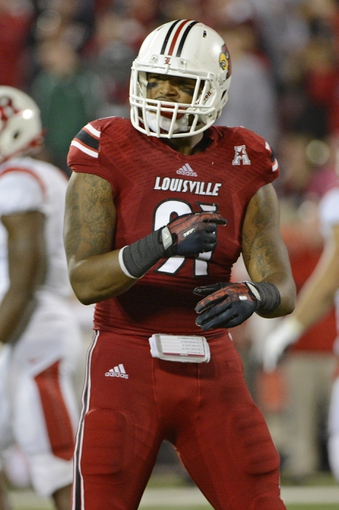 Oct 10, 2013; Louisville, KY, USA; Louisville Cardinals defensive end Marcus Smith (91) reacts during the second half against the Rutgers Scarlet Knights at Papa John's Cardinal Stadium. Mandatory Credit: Jamie Rhodes-USA TODAY Sports