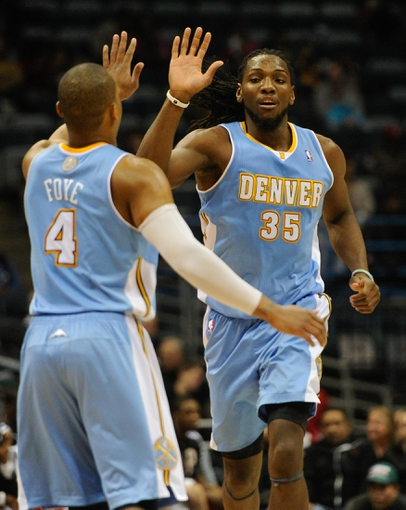 Feb 20, 2014; Milwaukee, WI, USA;  Denver Nuggets forward Kenneth Faried (35) is greeted by guard Randy Foye (4) after scoring a basket during the game against the Milwaukee Bucks in the 3rd quarter at BMO Harris Bradley Center. Faried scored 26 points to help the Nuggets beat the Bucks 101-90.  Mandatory Credit: Benny Sieu-USA TODAY Sports
