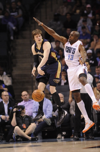 Feb 21, 2014; Charlotte, NC, USA; New Orleans Pelicans forward Luke Babbitt (8) passes the ball as he is defended by Charlotte Bobcats forward Anthony Tolliver (43) during the first half of the game at Time Warner Cable Arena. Mandatory Credit: Sam Sharpe-USA TODAY Sports