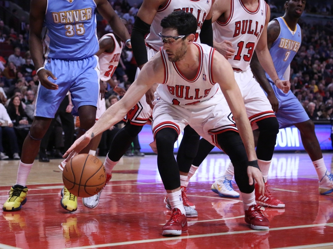 Feb 21, 2014; Chicago, IL, USA; Chicago Bulls shooting guard Kirk Hinrich (12) scrambles for the ball during the second quarter against the Denver Nuggets  at the United Center. Mandatory Credit: Dennis Wierzbicki-USA TODAY Sports