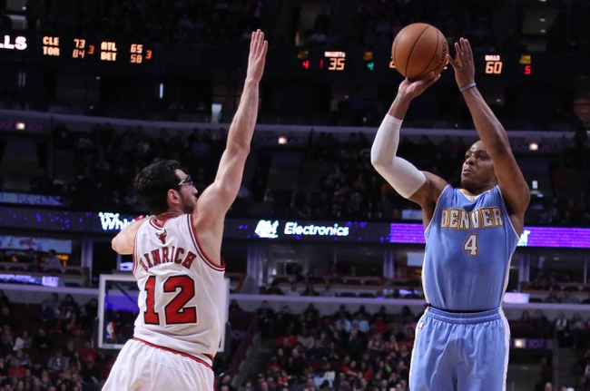 Feb 21, 2014; Chicago, IL, USA; Denver Nuggets shooting guard Randy Foye (4) shoots over Chicago Bulls shooting guard Kirk Hinrich (12) during the second quarter at the United Center. Mandatory Credit: Dennis Wierzbicki-USA TODAY Sports