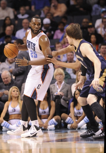 Feb 21, 2014; Charlotte, NC, USA; Charlotte Bobcats center Al Jefferson (25) holds the ball as New Orleans Pelicans forward Luke Babbit (8) defends during the second at Time Warner Cable Arena. The Bobcats won 90-87. Mandatory Credit: Sam Sharpe-USA TODAY Sports