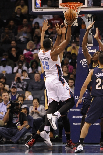Feb 21, 2014; Charlotte, NC, USA; Charlotte Bobcats center Al Jefferson (25) shoots the ball in front of New Orleans Pelicans forward center Anthony Davis (23) during the second half at Time Warner Cable Arena. The Bobcats won 90-87. Mandatory Credit: Sam Sharpe-USA TODAY Sports