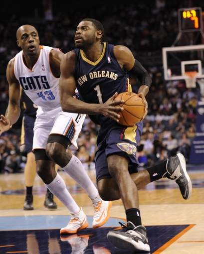 Feb 21, 2014; Charlotte, NC, USA; New Orleans Pelicans forward guard Tyreke Evans (1) drives past Charlotte Bobcats forward Anthony Tolliver (43) during the second half of the game at Time Warner Cable Arena. Bobcats win 90-87. Mandatory Credit: Sam Sharpe-USA TODAY Sports