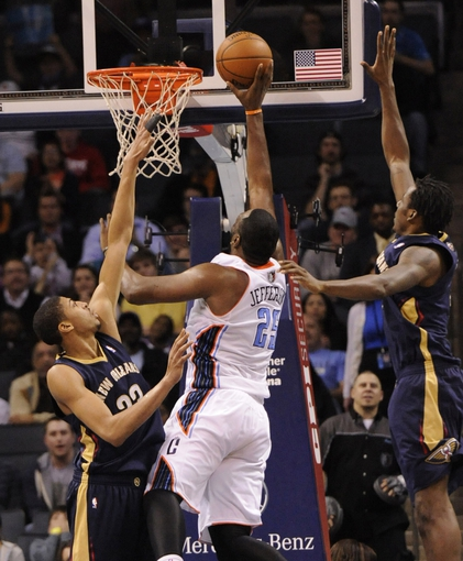 Feb 21, 2014; Charlotte, NC, USA; Charlotte Bobcats center Al Jefferson (25) drives past New Orleans Pelicans forward center Anthony Davis (23) during the second half of the game at Time Warner Cable Arena. Bobcats win 90-87. Mandatory Credit: Sam Sharpe-USA TODAY Sports