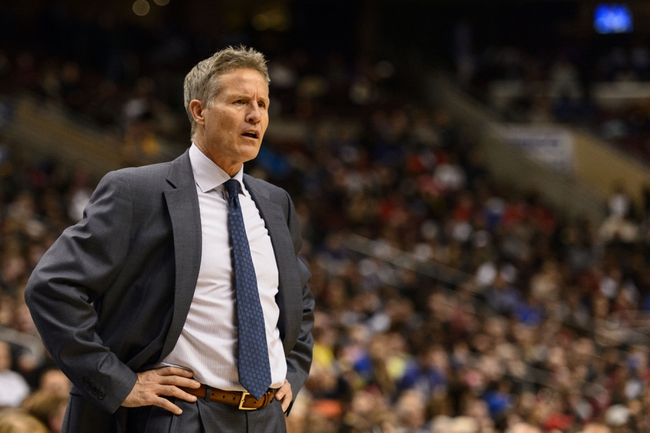 Feb 21, 2014; Philadelphia, PA, USA; Philadelphia 76ers head coach Brett Brown watches the action during the fourth quarter against the Dallas Mavericks at the Wells Fargo Center. The Mavericks defeated the Sixers 124-112. Mandatory Credit: Howard Smith-USA TODAY Sports