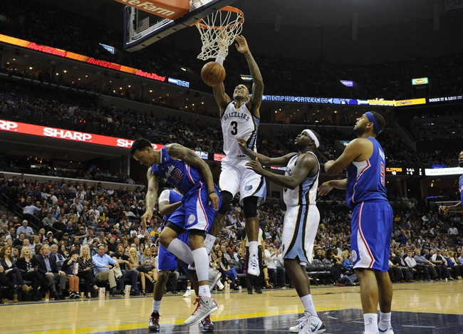 Feb 21, 2014; Memphis, TN, USA; Memphis Grizzlies power forward James Johnson (3) dunks the ball over Los Angeles Clippers small forward Matt Barnes (22) during the game at FedExForum. The Grizzlies won 102 - 96. Mandatory Credit: Justin Ford-USA TODAY Sports