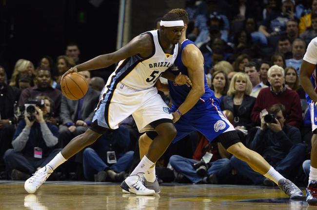 Feb 21, 2014; Memphis, TN, USA; Memphis Grizzlies power forward Zach Randolph (50) dribbles the ball as  Los Angeles Clippers power forward Blake Griffin (32) defends at FedExForum. The Grizzlies won 102 - 96. Mandatory Credit: Justin Ford-USA TODAY Sports
