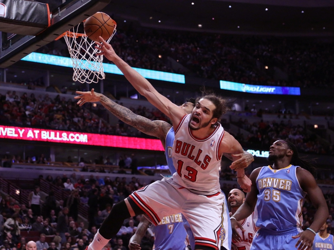 Feb 21, 2014; Chicago, IL, USA; Chicago Bulls center Joakim Noah (13) fights for a rebound during the second half against the Denver Nuggets at the United Center. Chicago won 117-89. Mandatory Credit: Dennis Wierzbicki-USA TODAY Sports